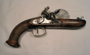 Click to enlarge a French Empire Style flintlock powder tester circa 1800